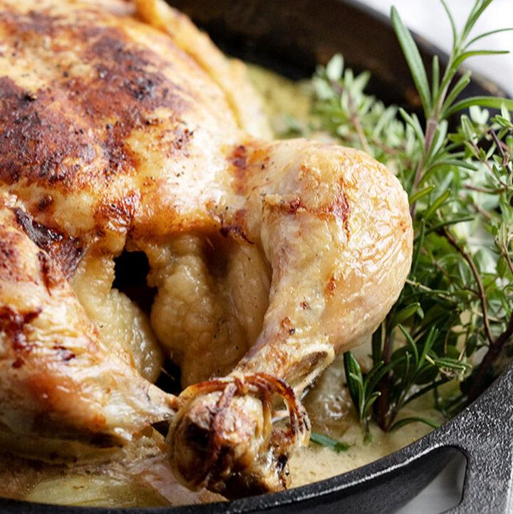 milk braised chicken with herbs in cast iron skillet