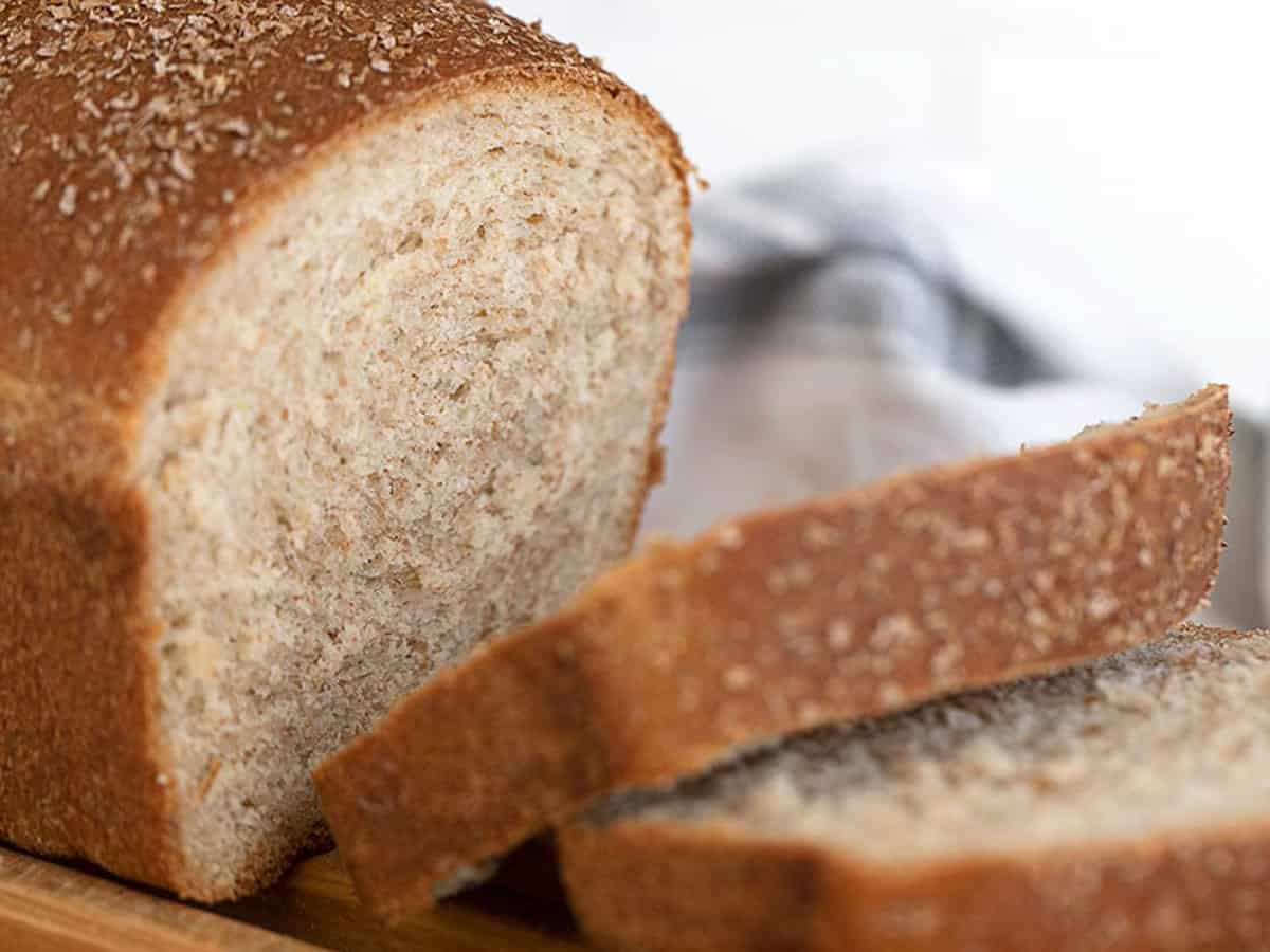 honey whole wheat seed bread sliced on cooling rack
