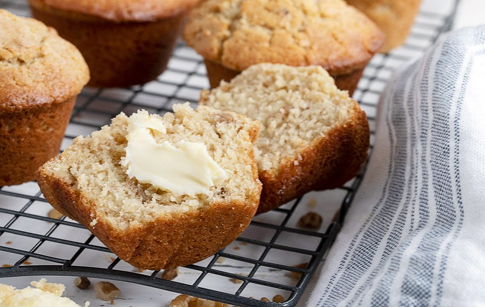 maple walnut muffin cut in half with butter