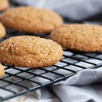 gingersnap cookies sitting on cooling rack