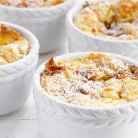 marmalade bread pudding in white ramekins