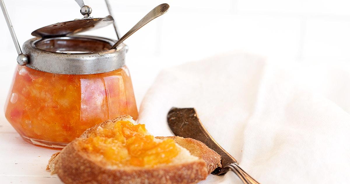 orange marmalade in jar and on toast