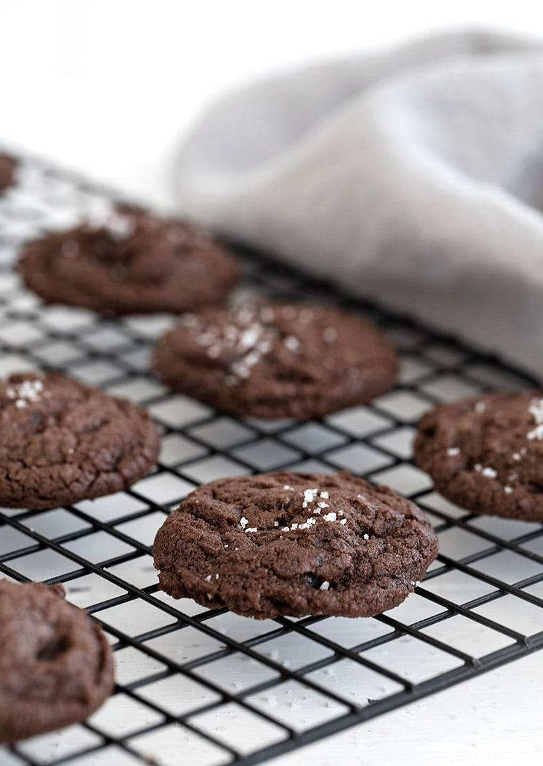 salted chocolate cookies on cooling rack landscape view