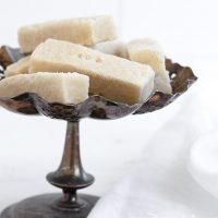shortbread cookies sitting on a vintage silver stand