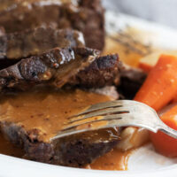 pot roast sliced on plate with carrots
