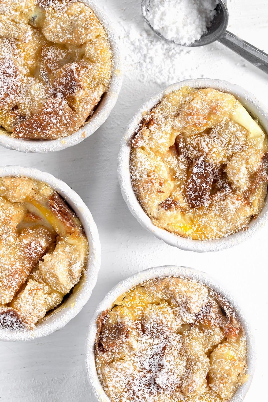 overhead view of marmalade bread pudding in ramekins