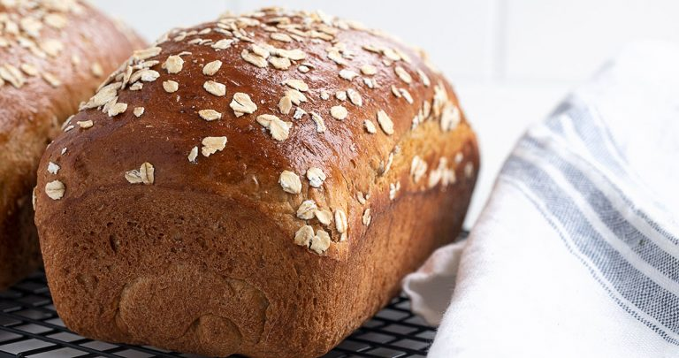 oatmeal molasses bread loaves on cooling rack