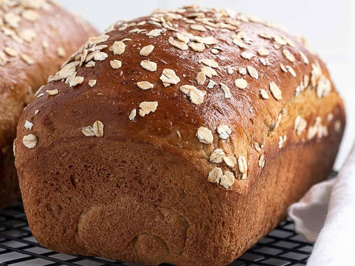 oatmeal molasses bread on cooling rack
