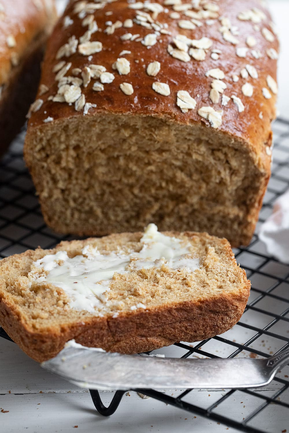 oatmeal molasses bread sliced and buttered