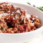 baked pork meatballs and pasta in white bowl