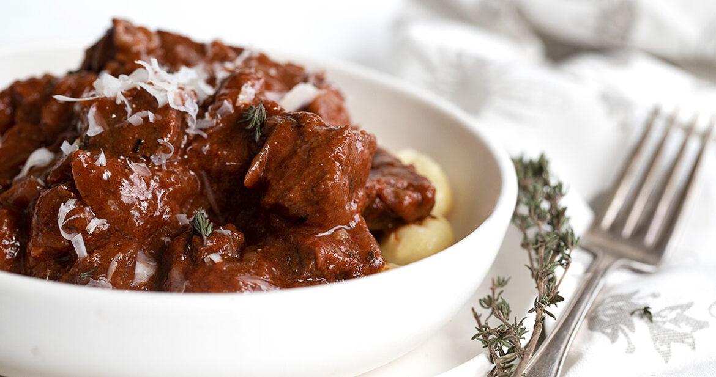 Italian Goulash in white bowl with gnocchi