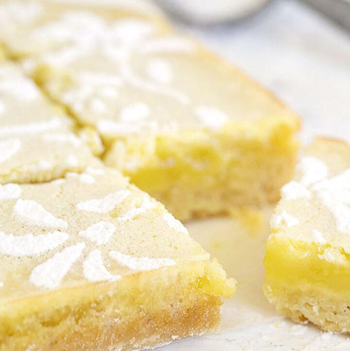 lemon squares cut on parchment