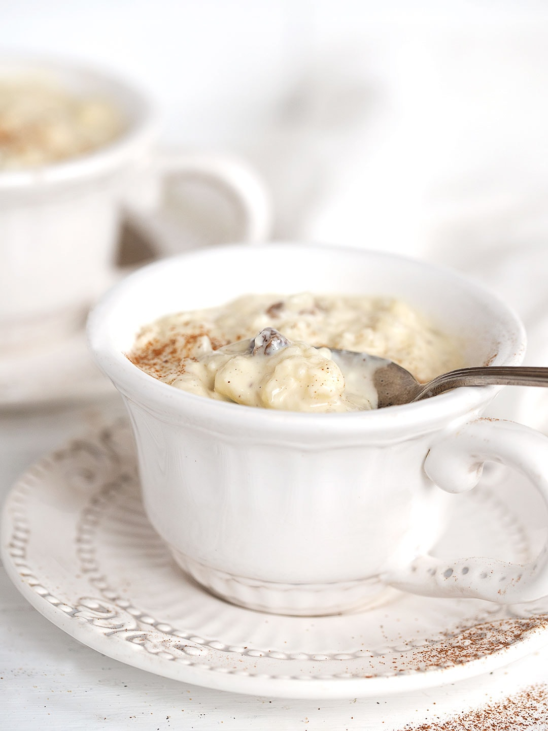 rice pudding in tea cups with spoon
