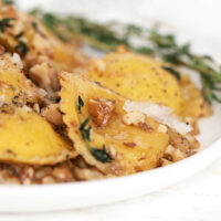 brown butter and walnut ravioli in white bowl