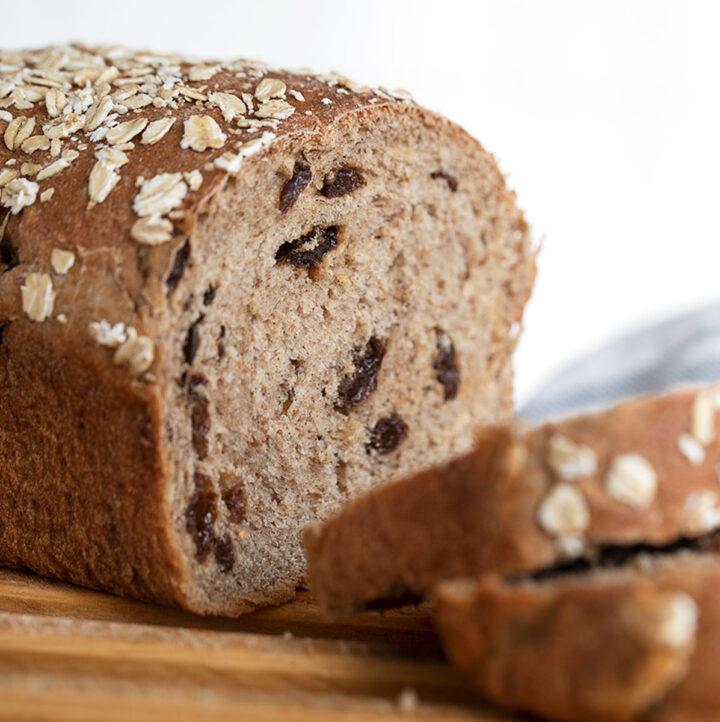cinnamon raisin oatmeal bread on cutting board sliced