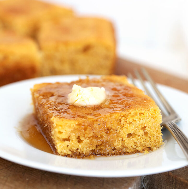 johnny cake with maple syrup and butter on plate
