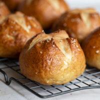 soft pretzel buns on cooling rack
