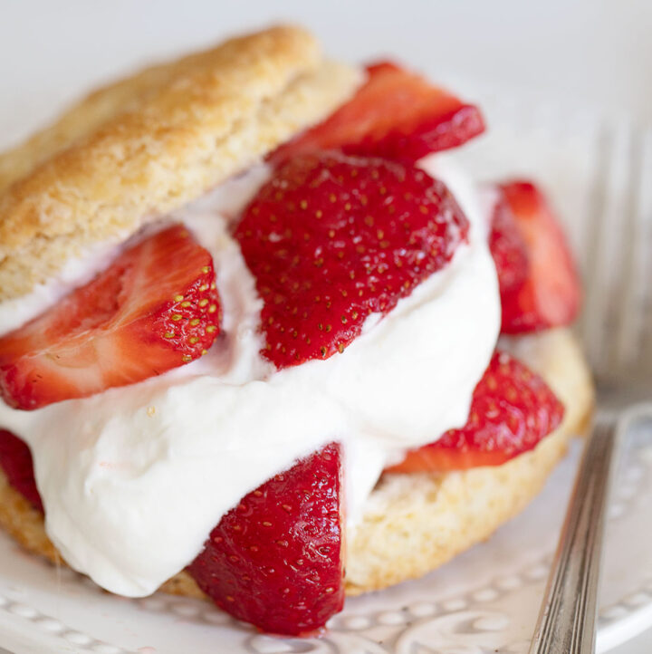 old-fashioned strawberry shortcake on plate with fork