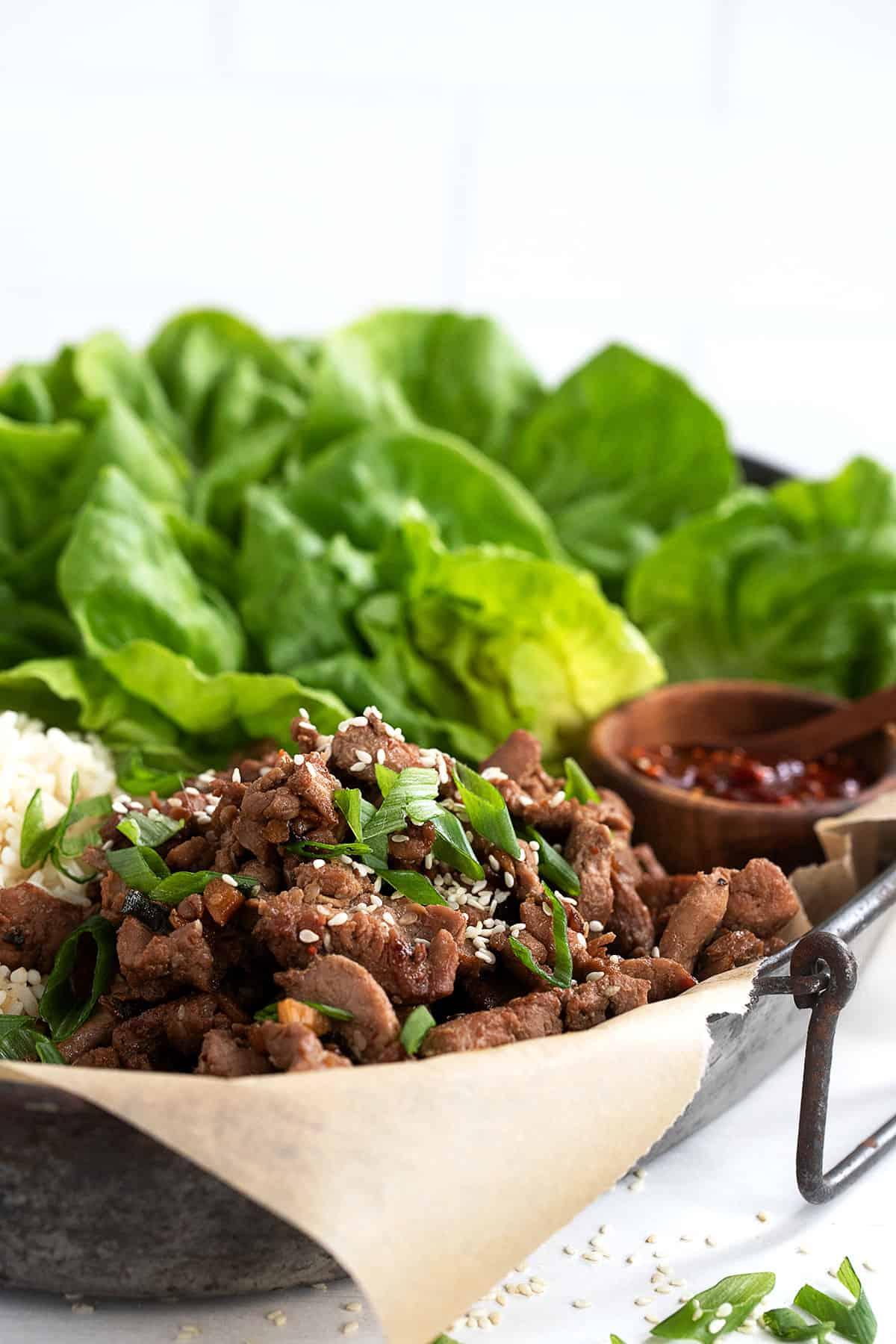 pork bulgogi on platter with rice and lettuce