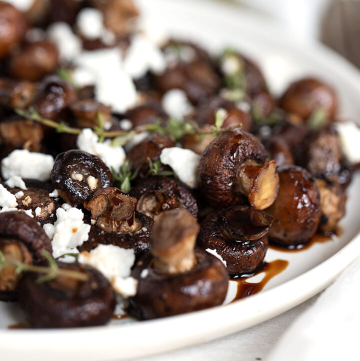 air fried mushrooms in bowl with balsamic and goat cheese