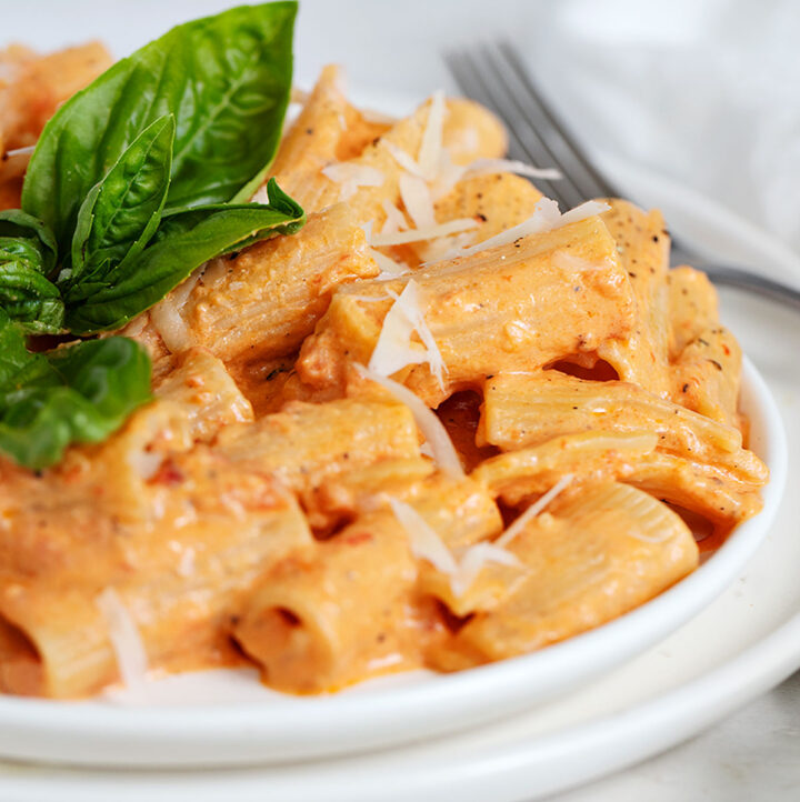 roasted red pepper pasta on plate with basil