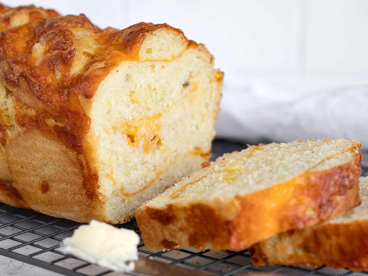 jalapeno corn cheese bread sliced on cooling rack