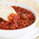 salsa in white bowl with tortilla chips