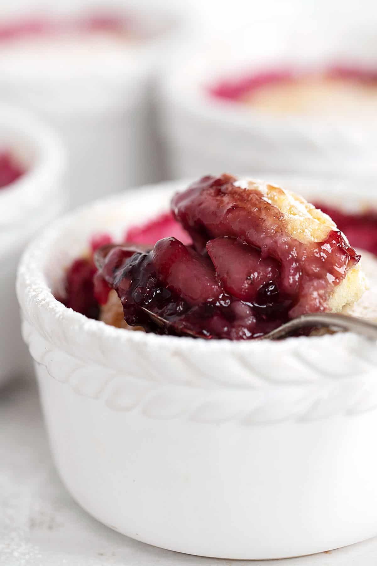 blackberry cobbler in ramekin with spoon