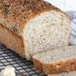 seeded multigrain bread sliced on cooling rack