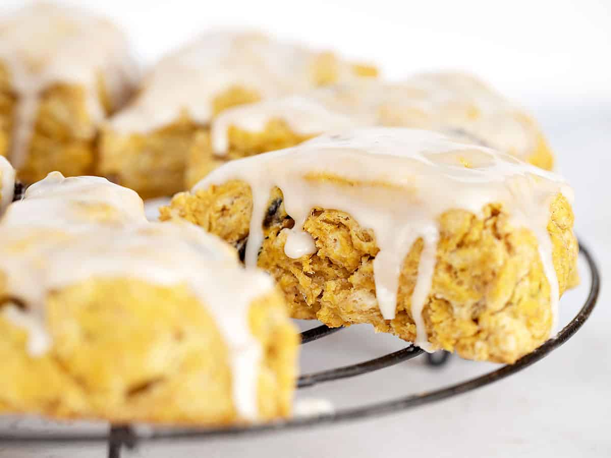 pumpkin scones with maple glaze on cooling rack