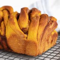 cinnamon swirl pumpkin yeast bread on cooling rack