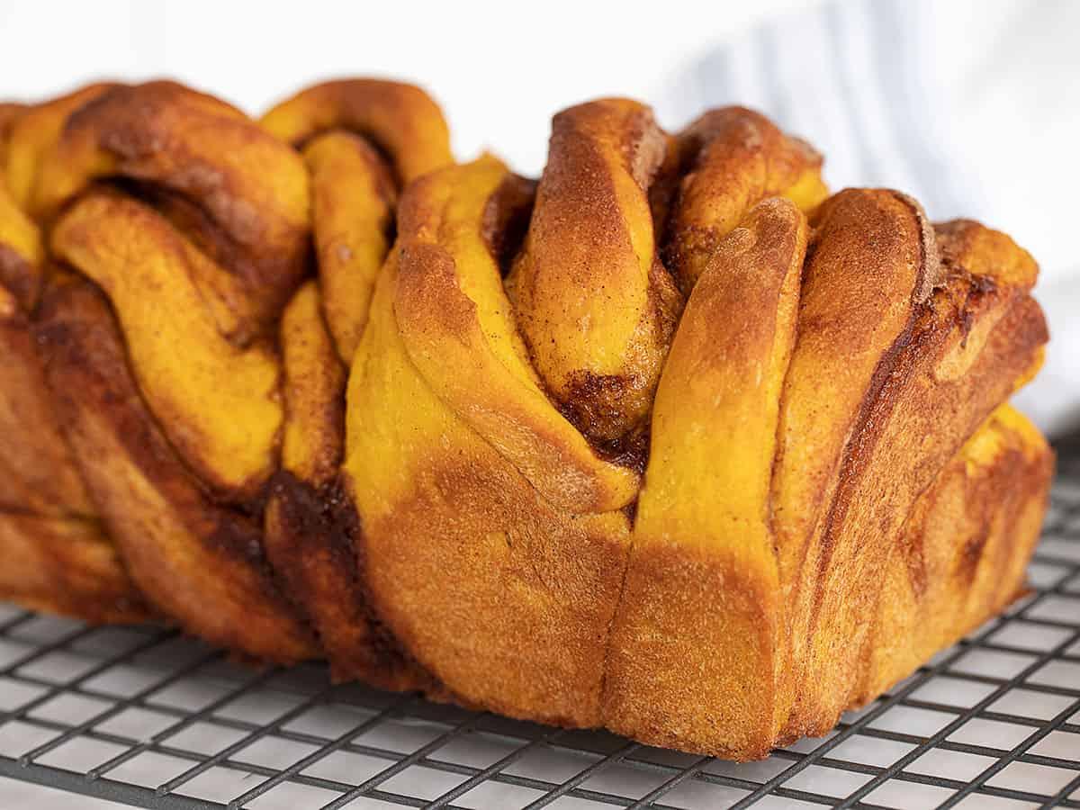 pumpkin cinnamon swirl yeast bread on cooling rack
