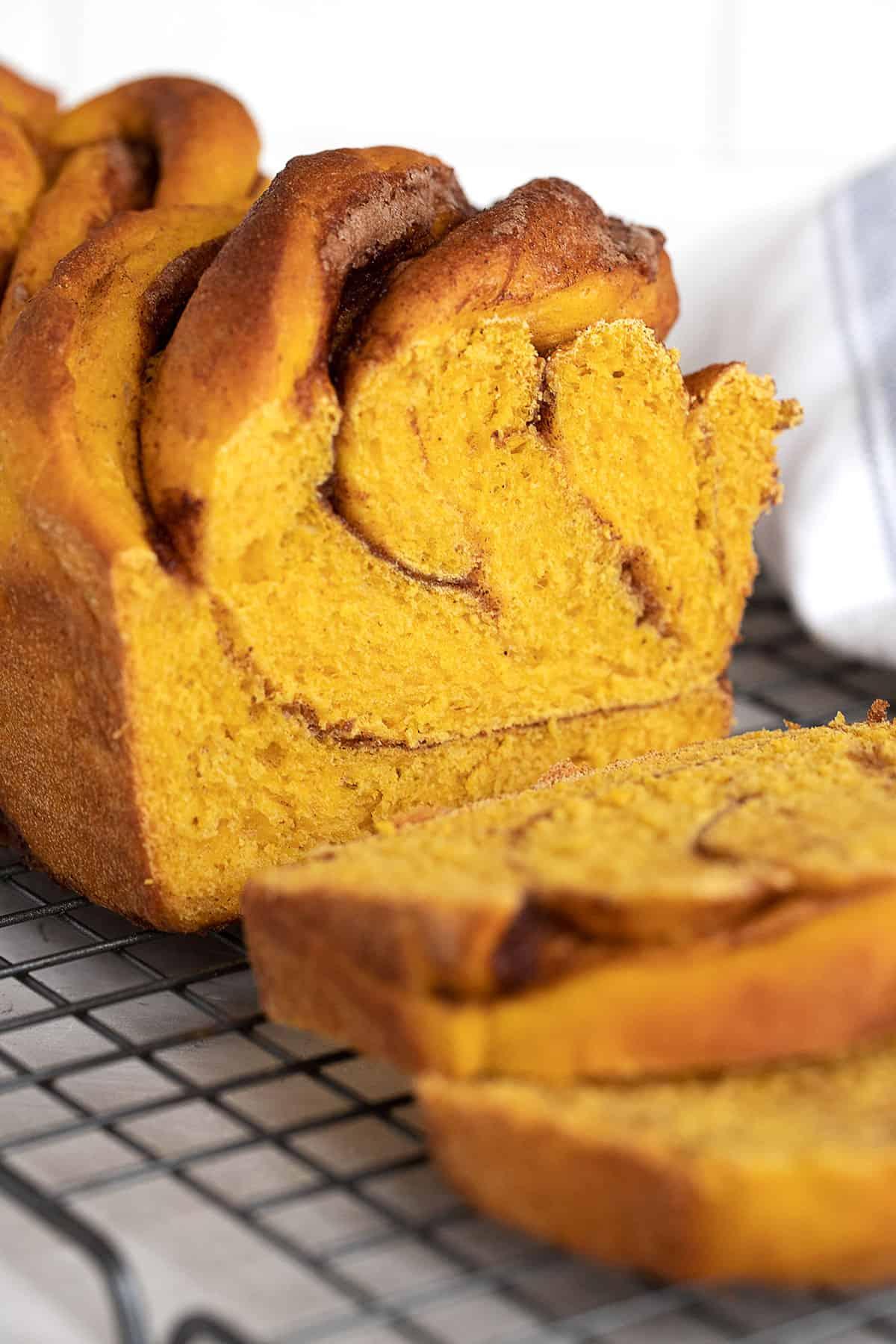 pumpkin cinnamon swirl yeast bread on cooling rack sliced